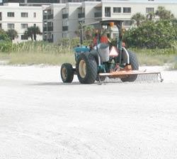 beach rake in action on sunset beach
