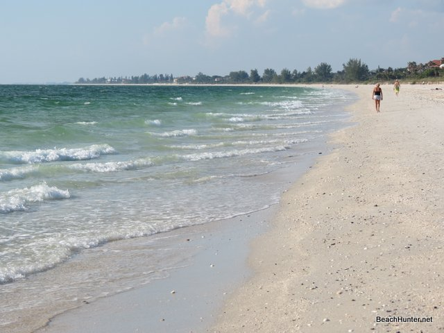 Walking on a quiet beach on Casey Key, FL