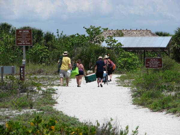 Cayo Costa day visitors walking back to the tram station.
