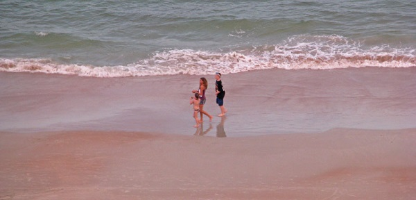 People walking on Daytona Beach, Florida.