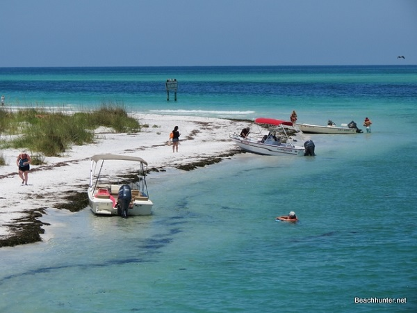 Boaters and beach walkers enjoying Beer Can Island on Longboat Pass, Florida.