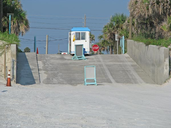 Beach driving ramp for cars on New Smyrna Beach.