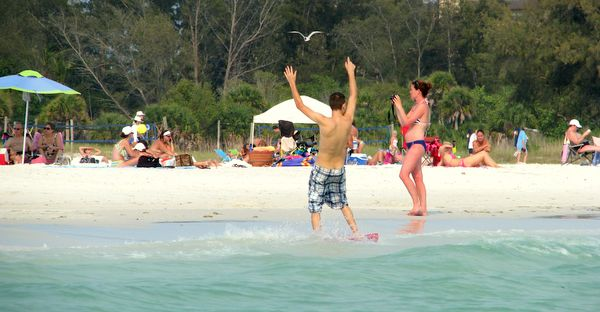 Having fun on Siesta Key Public Beach, Sarasota, Florida.