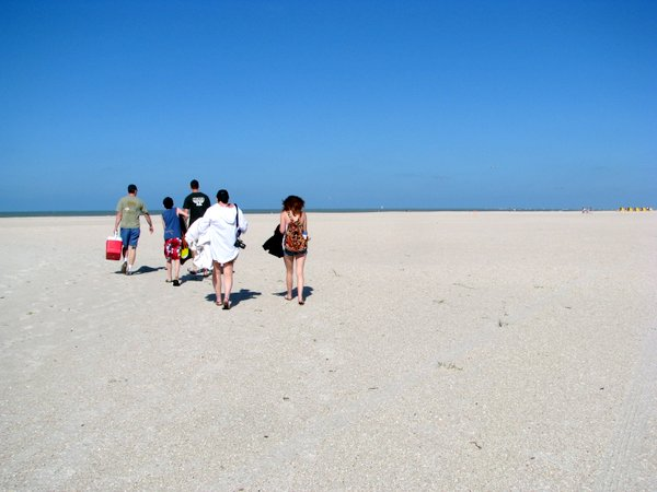 It's a long walk to the water on Treasure Island, Florida beach.