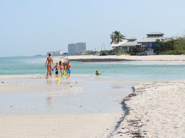 Family enjoying Clam Pass beach, Naples, Florida.